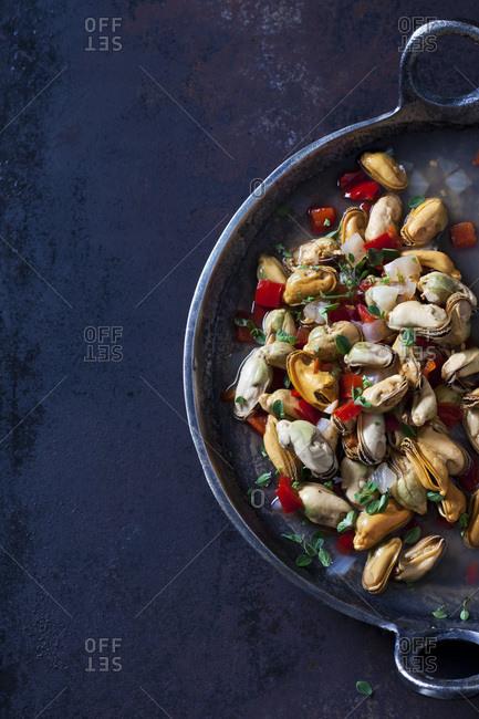 Prepared blue mussels in braising pan