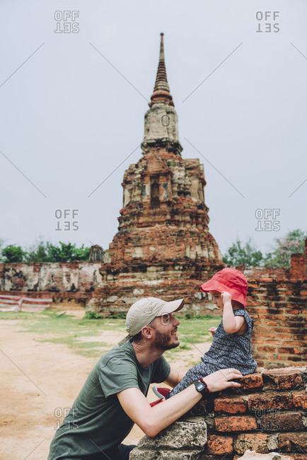 Thailand- Ayutthaya- Father and baby girl in the ancient ruins of Wat Mahathat temple