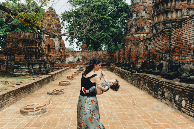 Thailand- Ayutthaya- Mother and daughter playing in the ancient ruins of a temple at Wat Mahathat