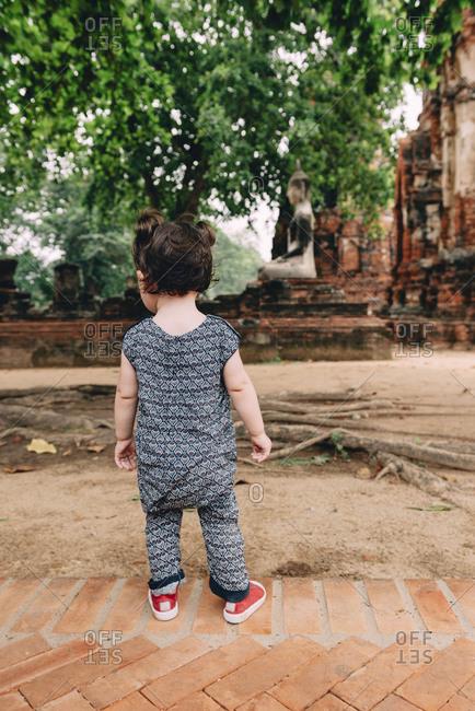 Thailand- Ayutthaya- Baby girl exploring Wat Mahathat temple