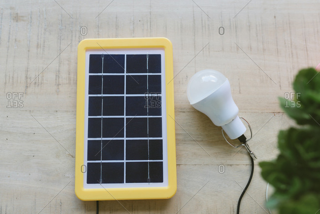 Renewable energy technology- solar panel charging a light bulb