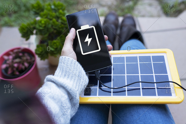 Renewable energy technology- solar panel charging a mobile phone battery