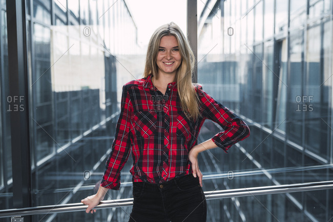Portrait of smiling young woman wearing plaid shirt