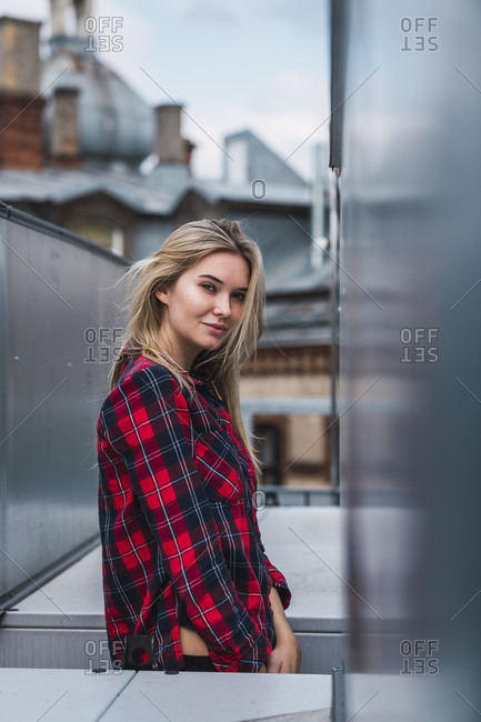 Portrait of smiling blond young woman wearing plaid shirt