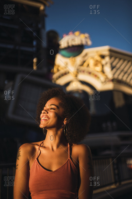 USA- Nevada- Las Vegas- portrait of happy young woman in the city at night