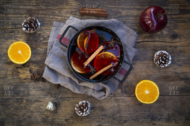 Cooking pot of mulled wine with orange slices- cinnamon sticks- star anise and cloves at Christmas time