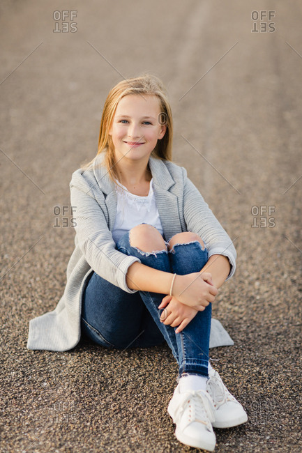 Portrait of smiling girl sitting on ground