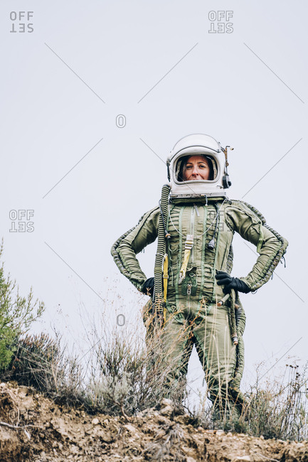 Woman in space suit exploring nature
