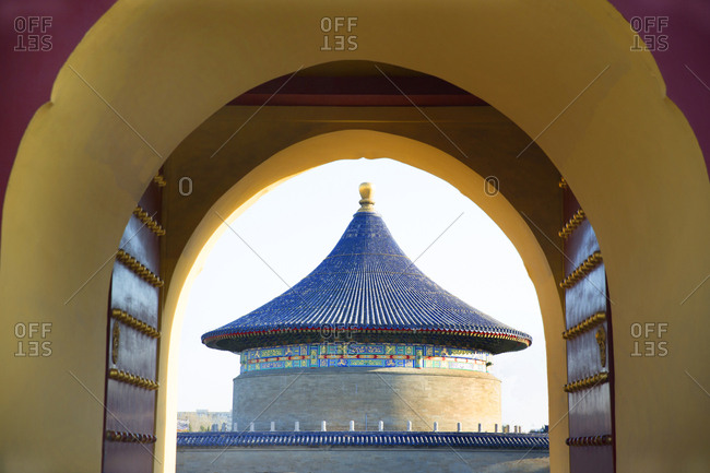 View through an arch of a temple in the Forbidden City palace complex in Beijing, China