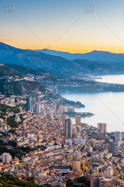 France, Provence-Alpes-Cote d'Azur, French Riviera, Alpes-Maritimes, Principality of Monaco. Monaco skyline at sunrise from the Tete de Chien.