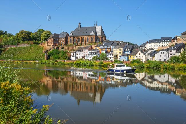 Saarburg - August 22, 2018: View at Saarburg with church St. Laurentius, river Saar and river Leuk, Rhineland-Palatinate, Germany