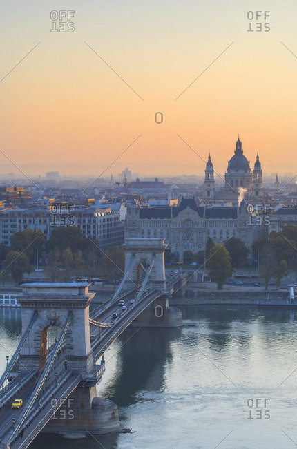 Hungary - October 15, 2018: Chain Bridge (Szechenyi Bridge) and St Stephen's Basilica at sunrise, Budapest, Hungary