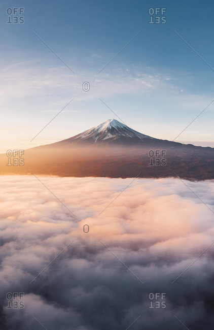 Aerial view of Mt Fuji and sea of fog at sunrise, Yamanashi Prefecture, Japan.