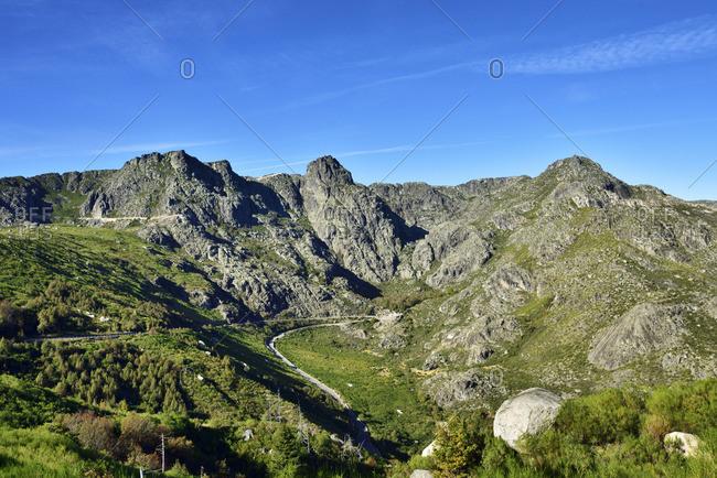 The source of the Zezere river. Covao da Ametade and the three peaks from where flows the river. Serra da Estrela Nature Park, Portugal