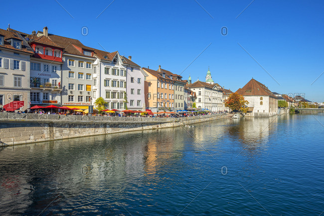 Switzerland - October 13, 2018: River Aare with Landhaus and St. Ursen cathedral, Solothurn, Switzerland