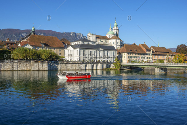 Switzerland - October 13, 2018: River Aare with St. Ursen cathedral, Solothurn, Switzerland