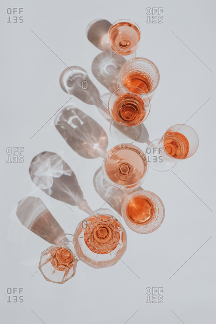 Overhead view of drinking glasses on a white table