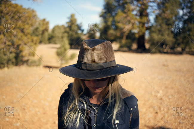 Woman wearing a hat outside in nature