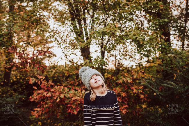 Little girl making a funny face during the fall