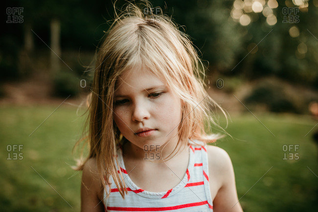 A little girl thinking with crazy hair