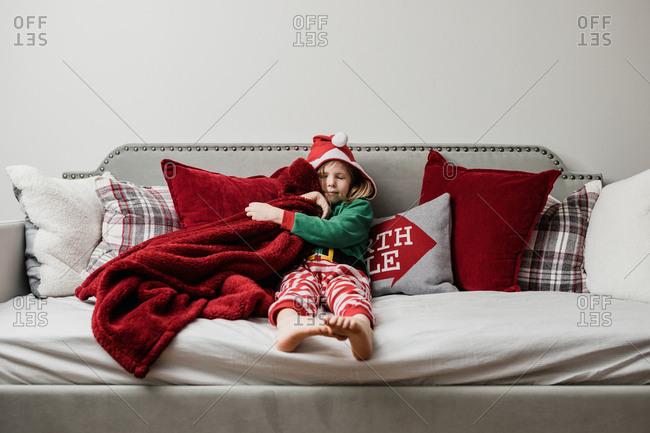 Little girl cuddling her blankie