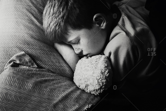 Young boy sleeping during the day because he is sick