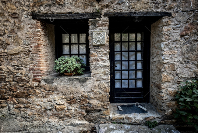Rustic architecture in the village of Castelnou, within the list of Les plus beaux towns of France