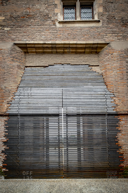 Modern door on the facade of the Berbie palace with the river Tarn in the background in the city of Albi in France