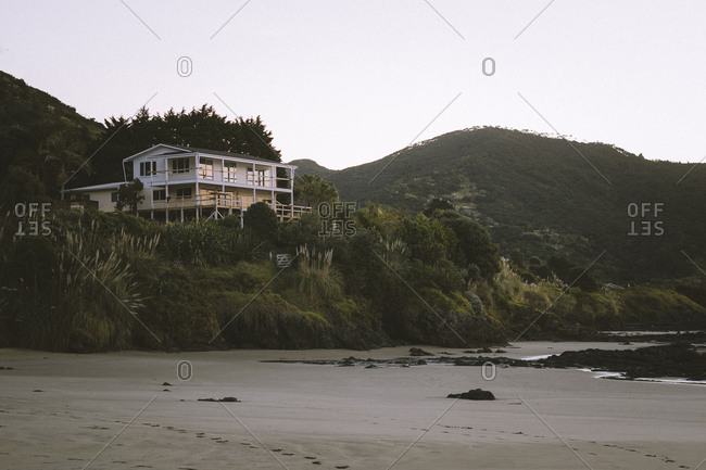 Sunset view of a elevated stilt house on the beach