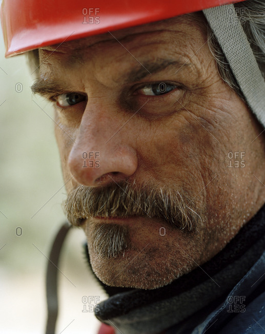 Portrait of a mature man wearing a hardhat.