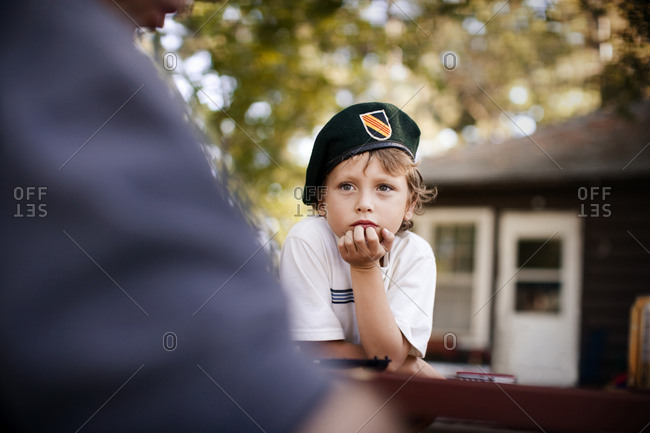 boy wearing army cap