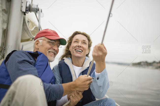 Mature couple sailing.
