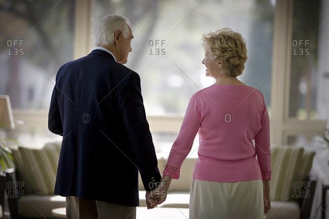 Elderly couple holding hands - Offset