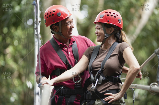 Woman and man on ropes course