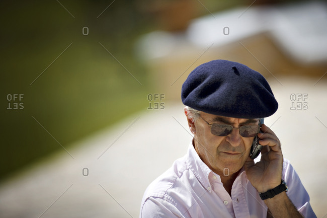 View of a man conversing over the phone.