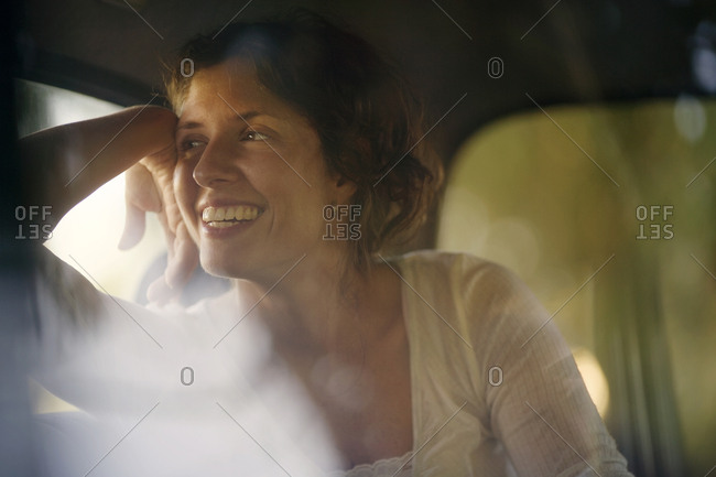 View of a young woman sitting in a car.
