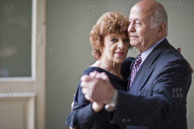 Portrait of a mature woman dancing with her senior husband.