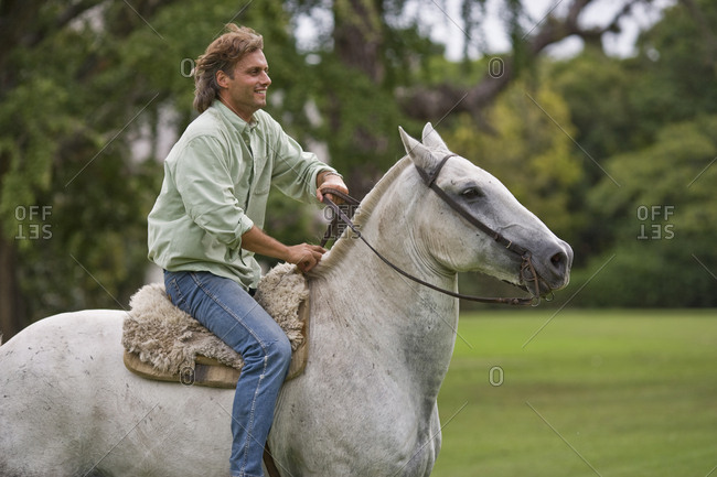 Man riding a white horse