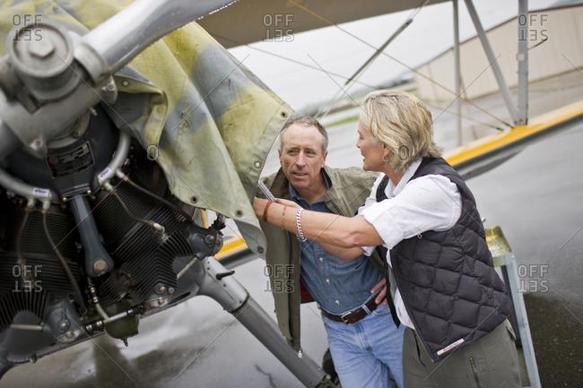 Woman repairing airplane propeller