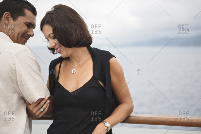 Couple relaxing on boat deck aboard a cruise ship.
