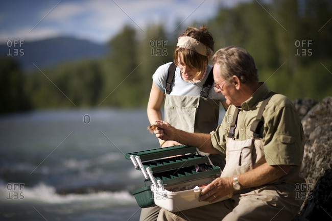 Father and adult daughter fly fishing together