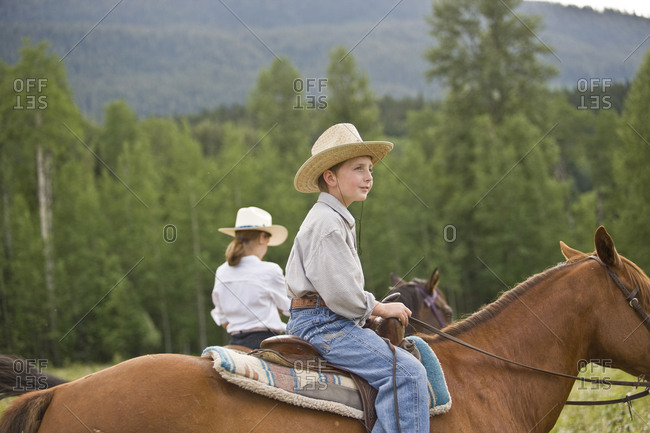 Boy and girl horseriding