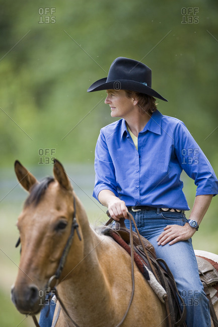 Mature woman on horseback