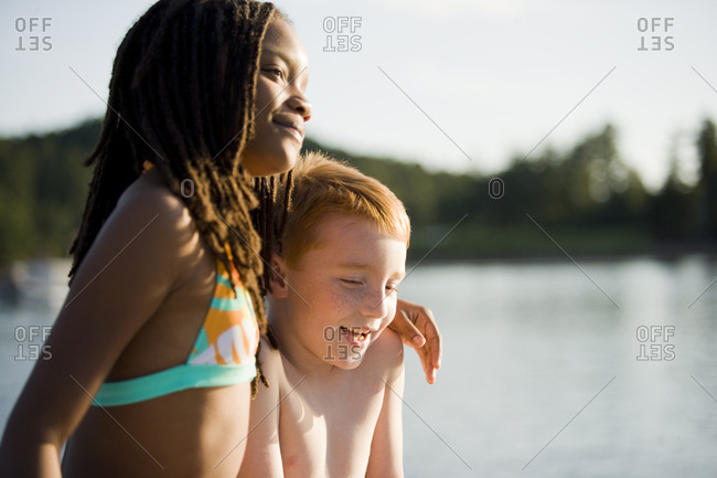 Boy and girl beside a lake