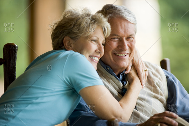 Older couple smiling with arms around each other