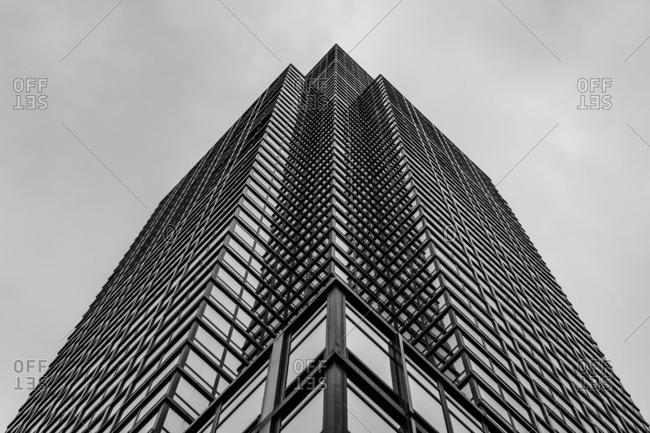 New York City - USA - DEC 17 2018: Underside panoramic and perspective view to facade fragment of a modern building in midtown Manhattan