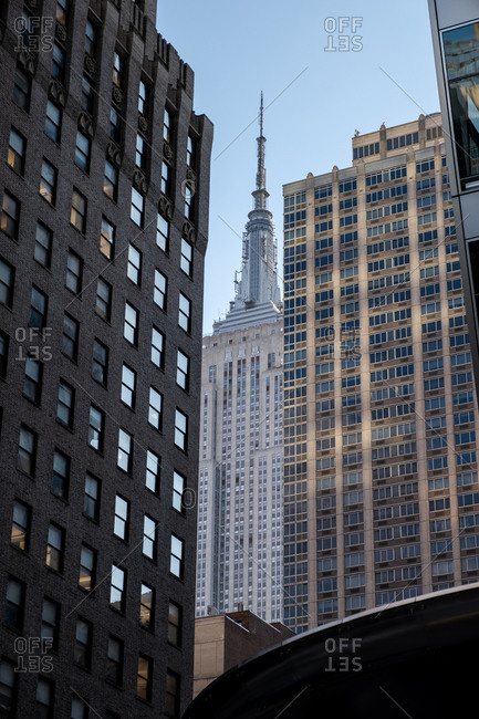 New York City - USA - DEC 26 2018: Perspective view to facade fragment of the modern building and Empire State Building in midtown Manhattan