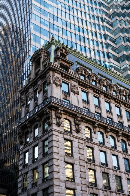 New York City - USA - DEC 26 2018: Perspective view to facade fragment of the modern and old building in midtown Manhattan