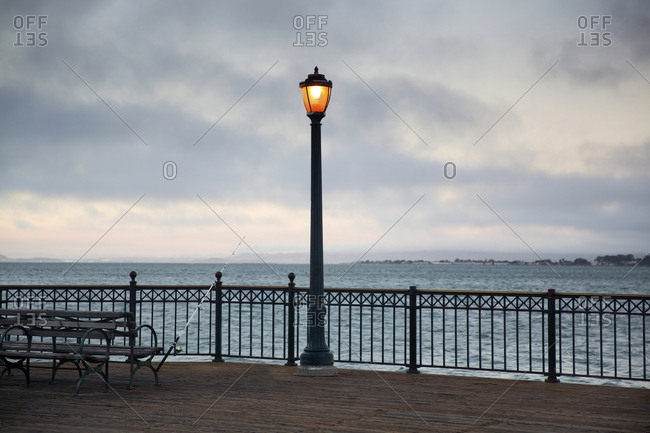 Fishing pole and street lamp on pier in San Francisco