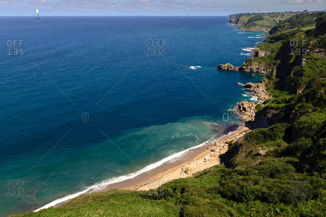 Picturesque drone view of tranquil blue sea near wonderful coast on beautiful sunny day